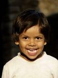 Sonrisa inocente foto de archivo libre de regalías