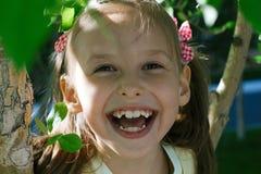 Sonrisa linda de la niña Imagen de archivo