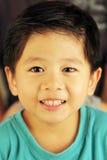 Sonrisa linda del niño Imagenes de archivo