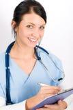 Sonrisa médica joven de la enfermera del doctor de la mujer Imagen de archivo libre de regalías