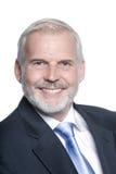 Sonrisa mayor del retrato del hombre de negocios amistosa Fotografía de archivo libre de regalías