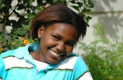 Sonrisa negra de la muchacha Imagenes de archivo