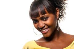 Sonrisa negra de la mujer joven Imágenes de archivo libres de regalías