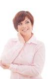 Sonrisa pensativa de la mujer de negocios Fotografía de archivo