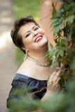 Sonrisa rechoncha de la mujer Imagen de archivo libre de regalías