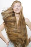Sonrisa rubia con el gran pelo largo Imagenes de archivo