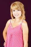 Sonrisa rubia de la muchacha del adolescente Imagen de archivo libre de regalías