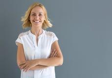 Sonrisa rubia de la mujer Fotografía de archivo libre de regalías