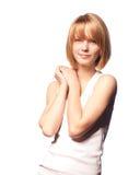 Sonrisa spoty agradable de la muchacha aislada en blanco. Imagen de archivo libre de regalías