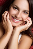 Sonrisa triguena de la muchacha Fotos de archivo libres de regalías