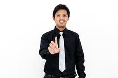 Sonrisa y mano del hombre de negocios para arriba que muestran la acción Imágenes de archivo libres de regalías