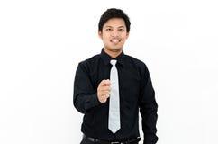 Sonrisa y mano del hombre de negocios para arriba que muestran la acción Fotos de archivo
