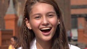 Sonrisa y muchacha adolescente emocionada Imágenes de archivo libres de regalías
