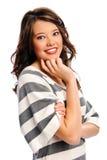 Sonrisas bonitas de la muchacha Foto de archivo libre de regalías