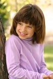 Sonrisas de la chica joven Imagen de archivo