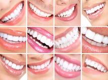 Sonrisas de la mujer Imagenes de archivo