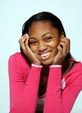 Sonrisas de la señora joven Imagenes de archivo