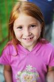 Sonrisas del niño Fotos de archivo