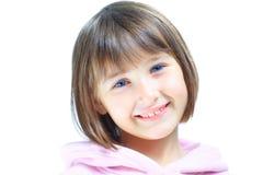 Sonrisas hermosas jovenes del niño de la muchacha Imagen de archivo libre de regalías