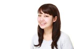Sonrisas japonesas de la mujer Foto de archivo
