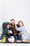 Sons giving a surprise to her mother. Young boy and girl giving a surprise to him mother Stock Images