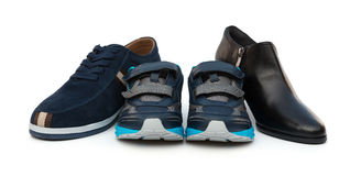 Sons shoes surrounded by dad & moms. Sons shoes surrounded by dad and moms royalty free stock photos