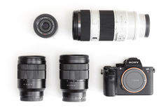 Sony Alpha mirrorless camera and E-mount lenses. Melbourne, Australia - Feb 10, 2016: Flat lay photo of Sony A7R II mirrorless camera and E-mount lenses. The stock images