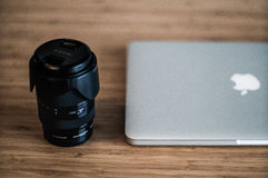 Sony Bridge Camera Lens Beside Macbook Stock Images