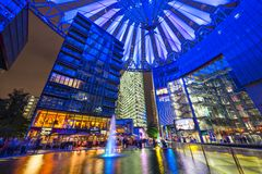 Sony Center. BERLIN, GERMANY - SEPTEMBER 20, 2013: The fountain at night in Sony Center.The center is a public space located in the Potsdamer Platz financial royalty free stock images