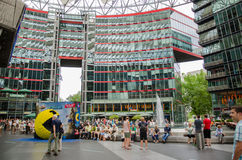 Sony Center in Berlin, Germany. June 2015 people in front of a advertising display for the movie Pixels, in Potsdamer Platz Royalty Free Stock Photography