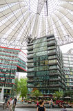 Sony Center in Berlin, Germany. June 2015 people walking or resting near the fontains Royalty Free Stock Photo