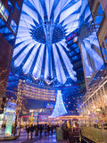 Sony Center Berlin. BERLIN - JANUARY 1 2016: Potsdamer platz, Sony Center with the futuristic roof top and a big Christmas tree royalty free stock photos