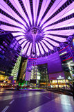 Sony Center Berlin lit by violet light. Overview of the Sony Center in the evening lit with violet light Stock Photography