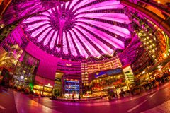 Sony Center Berlin. Berlin, Potsdamer Platz, May 13th 2016: People having a walk under the changing colours of the modern dome Royalty Free Stock Images