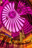 Sony Center Berlin. Berlin, Potsdamer Platz, May 13th 2016: People having a walk under the changing colours of the modern dome Royalty Free Stock Photos