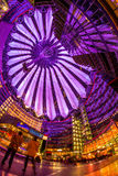 Sony Center Berlin. Berlin, Potsdamer Platz, May 13th 2016: People having a walk under the changing colours of the modern dome Stock Photo