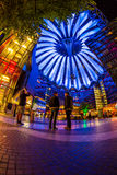 Sony Center Berlin. Berlin, Potsdamer Platz, May 13th 2016: People having a walk under the changing colours of the modern dome Stock Images