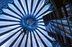 Sony center glass cupola in Berlin, Germany. Zenith shot of the cantilever cupola and adjacent buildings, lit at night, in the Sony Center, Potsdamer Platz stock photo