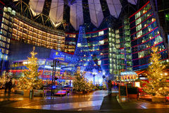 Sony Center on the Potsdamer Platz. Berlin, Germany - 29.11.2016. Sony Center on the Potsdamer Platz illuminated at night and with decorated christmas trees royalty free stock photography