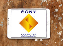 Sony computer entertainment logo. Logo of game developer company sony computer entertainment on samsung tablet on wooden background Royalty Free Stock Photos
