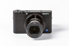 Sony Cyber-shot DSC-RX100 III, 21 megapixels. Photo of Sony Cyber-shot DSC-RX100 III, 21 megapixels 24-70 mm zoom mirrorless digital photo camera on a white Stock Photography