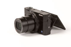 Sony Cyber-shot DSC-RX100 III, 21 megapixels. Photo of Sony Cyber-shot DSC-RX100 III, 21 megapixels 24-70 mm zoom mirrorless digital photo camera on a white Royalty Free Stock Photos