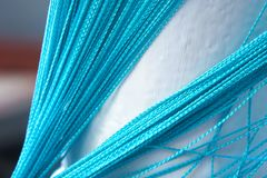 blue curtain of ropes Woven blue bright curtain of ropes hanging down stock images