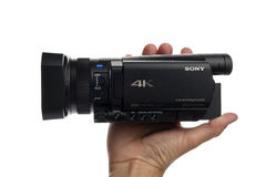 Sony FDR AX100 4k UHD Handycam Camcorder. NOVI SAD, SERBIA - APRIL 25, 2015: Person holding Sony FDR AX100, 4k UHD Handycam Camcorder captures Ultra High Royalty Free Stock Photo