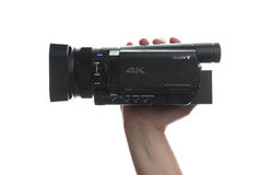 Sony FDR AX100 4k UHD Handycam Camcorder. NOVI SAD, SERBIA - APRIL 25, 2015: Person holding Sony FDR AX100, 4k UHD Handycam Camcorder captures Ultra High Royalty Free Stock Images