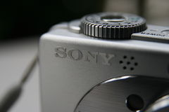 Sony inscription on silver compact camera. Sony Corporation is a Japanese multinational corporation leading in manufacturers of electronic products for the Royalty Free Stock Photography
