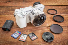Sony A6000 mirrorless digital camera. FORT COLLINS, CO, USA, April 17, 2015: Sony A6000 mirrorless digital camera with a set of filters, memory cards, lens cap Stock Image
