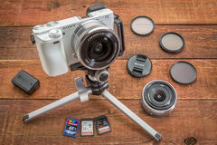 Sony A6000 mirrorless digital camera. FORT COLLINS, CO, USA, April 17, 2015: Sony A6000 mirrorless digital camera on a table tripod surrounded by a set of stock images