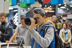 Sony photo camera booth during CEE 2017 in Kiev, Ukraine. People testing professional photographic cameras on Sony company booth during CEE 2017, the largest stock photo