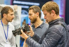Sony photo camera booth during CEE 2017 in Kiev, Ukraine. People testing professional photographic cameras on Sony company booth during CEE 2017, the largest Stock Image